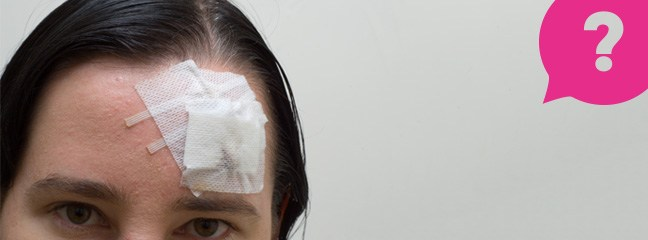 A woman with a plaster over a head wound