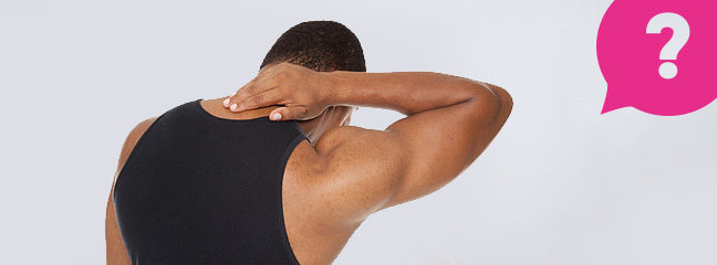 A man rubbing the back of his neck after suffering whiplash